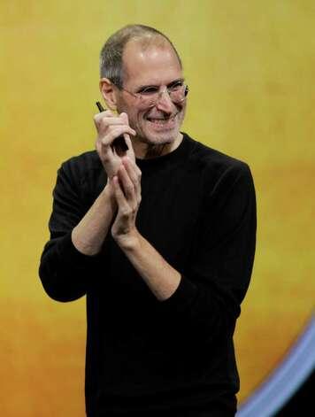 Apple CEO Steve Jobs smiles during the Apple news conference in San Francisco, Wednesday, Sept. 1, 2010. (AP Photo/Paul Sakuma) Photo: Paul Sakuma / AP