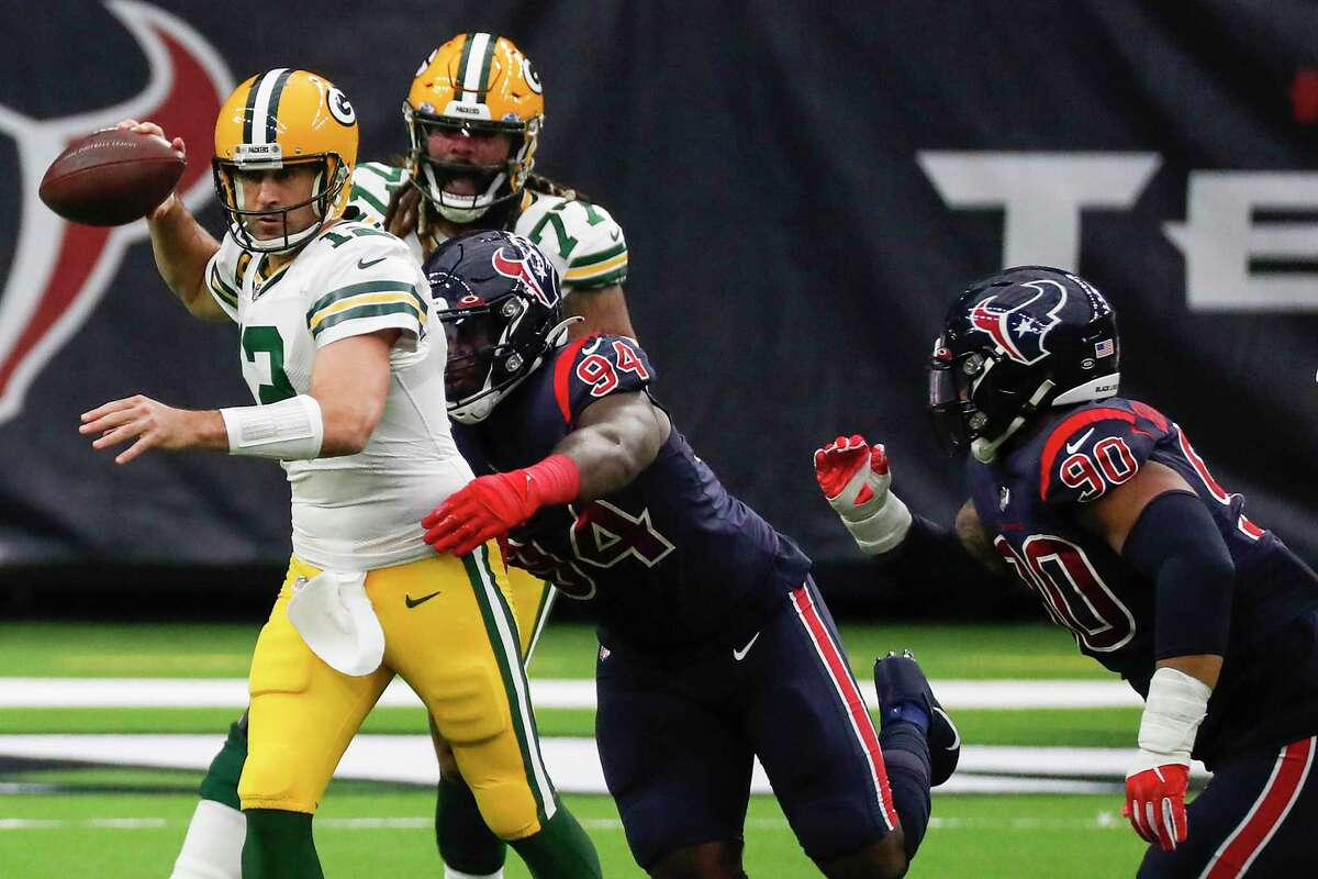 Charles Omenihu, pressuring Packers quarterback Aaron Rodgers, and Ross Blacklock (90) could see more action against Jacksonville if the Texans uses more linemen because they are without three linebackers.