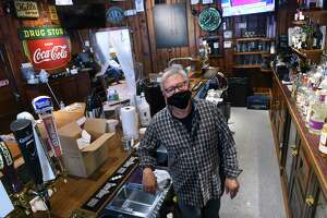 Bob Fuchs, owner of Archie Moore's, is photographed at the bar during restoration of the historic restaurant on Willow Street in New Haven on November 5, 2020.