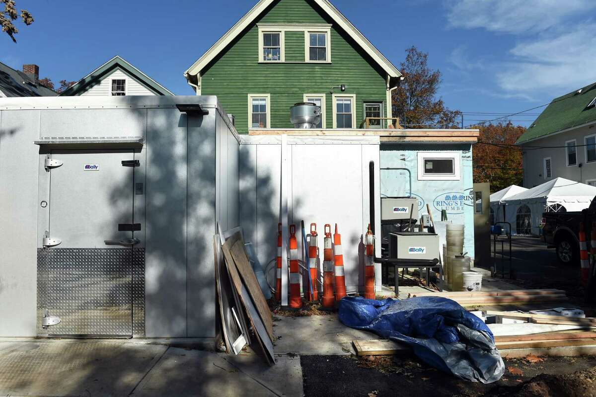 Additional freezer space is added to Archie Moore's bar/restaurant while the historic restaurant is closed during restoration on Willow Street in New Haven on November 5, 2020.
