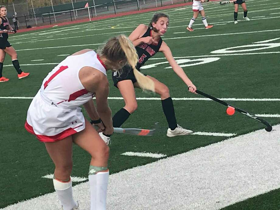 Zita Cohen of Greenwich, left, attempts to pass the ball up the field, while New Canaan's Molly Reed makes a play on the ball during a field hockey game at Greenwich High School on Thursday, November 5, 2020, in Greenwich, Connecticut. Photo: Contributed Photo