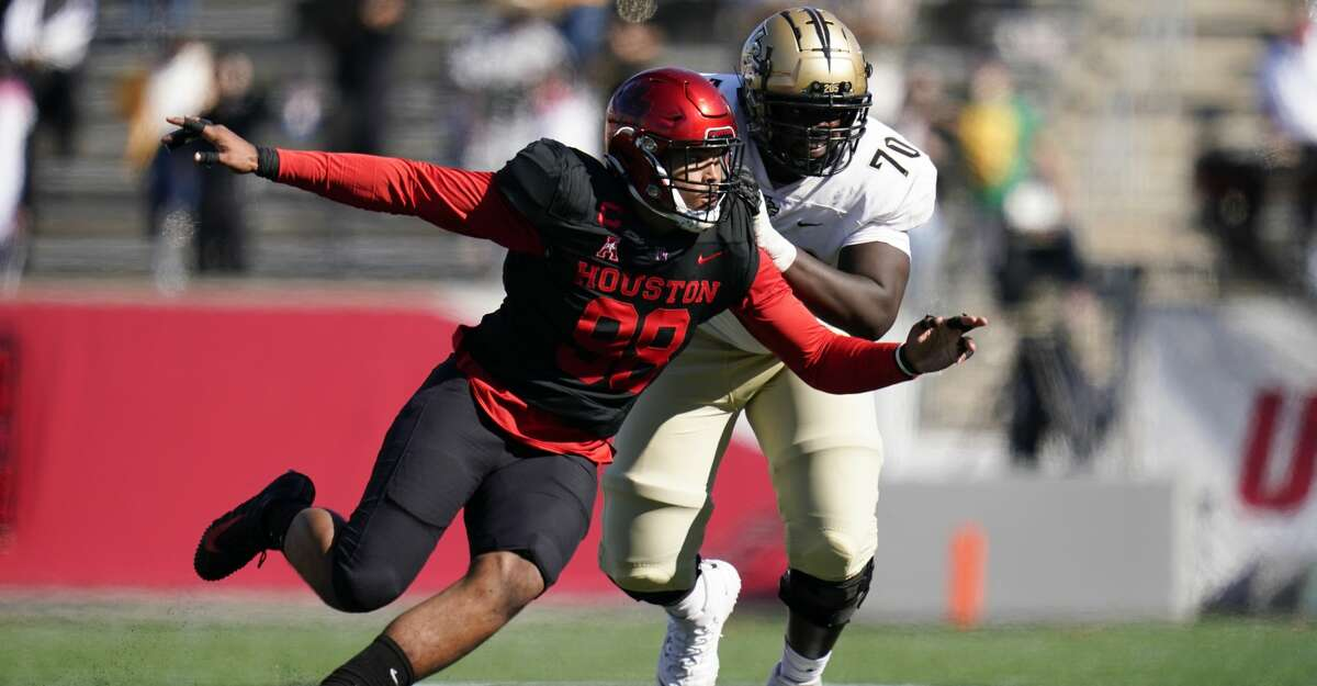 Houston defensive lineman Payton Turner (98) rushes against Edward Collins (70) during an NCAA football game against Central Florida on Saturday, Oct. 31, 2020 in Houston. (AP Photo/Matt Patterson)