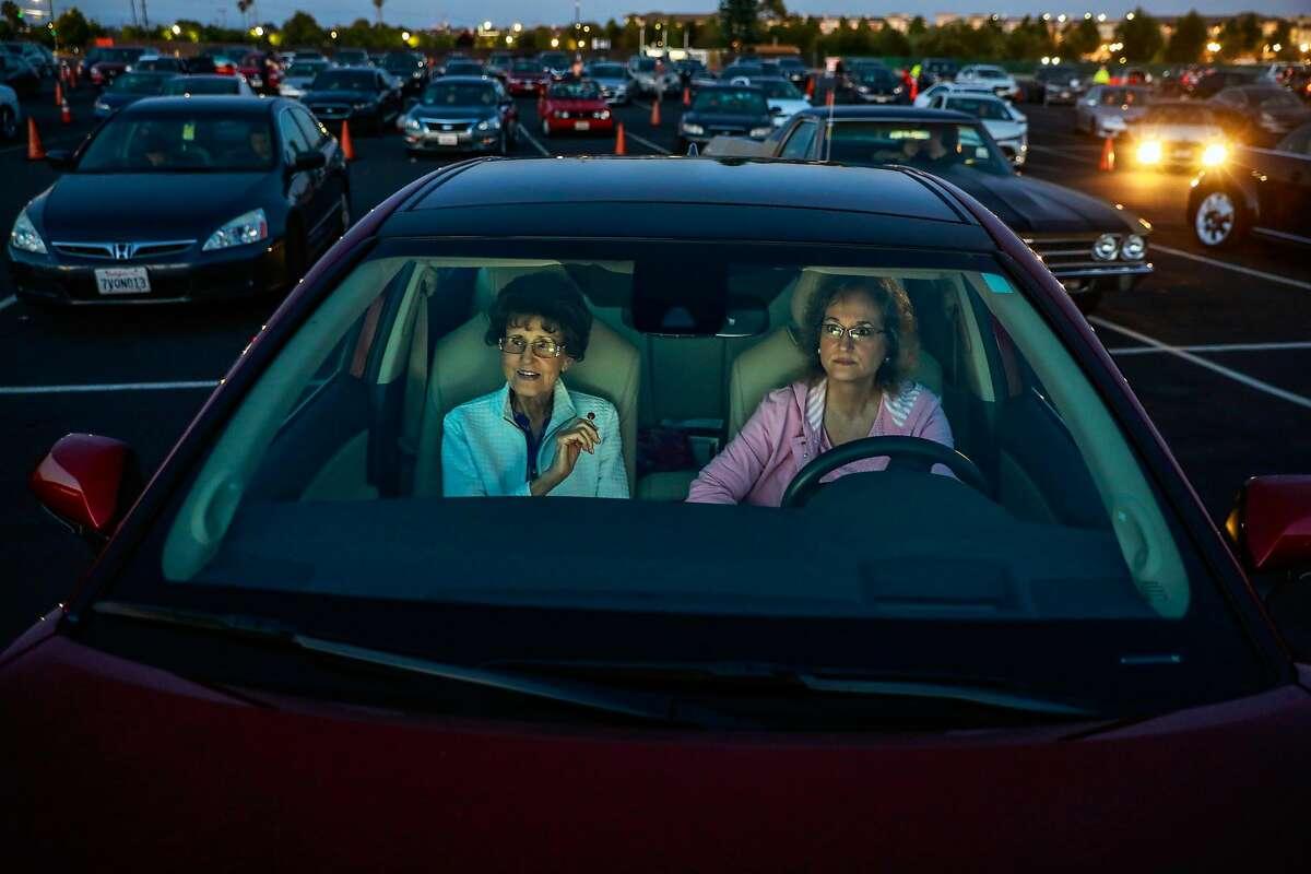 Cassie Hausauer (left) and her daughter Heidi Hausauer attend a drive-in movie in San Mateo.