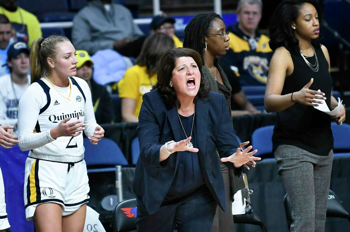 Quinnipiac head coach Tricia Fabbri, center, shouts to players during the first half of the championship NCAA college basketball game during the Metro Atlantic Athletic Conference women's tournament, Monday, March 11, 2019, in Albany, N.Y.