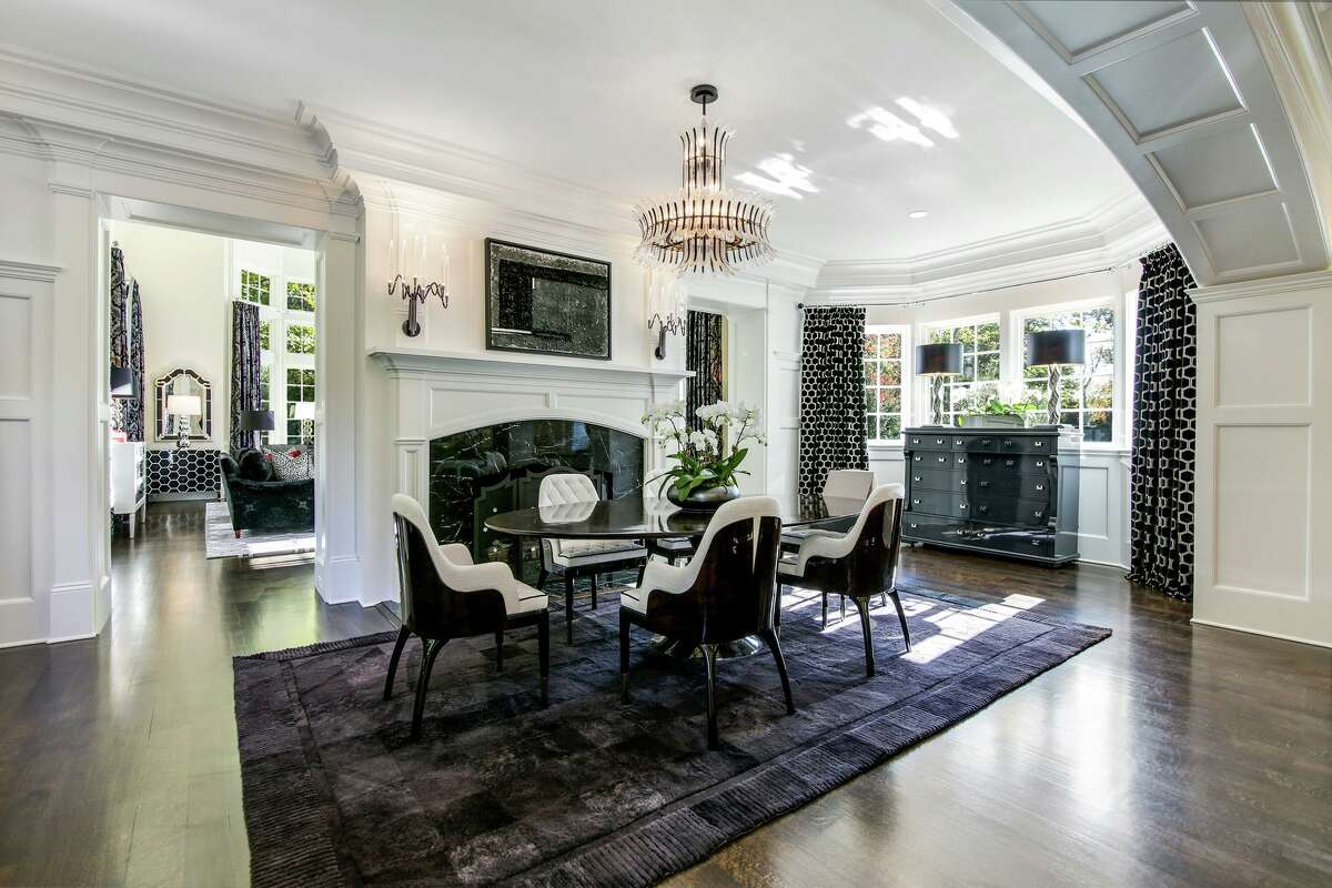 A paneled archway frames the dining room, where there's one of the home's nine fireplaces.
