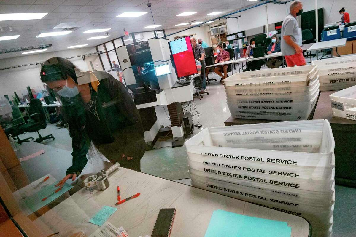 Poll workers count ballots inside the Maricopa County Election Department in Phoenix, Arizona on November 5, 2020.