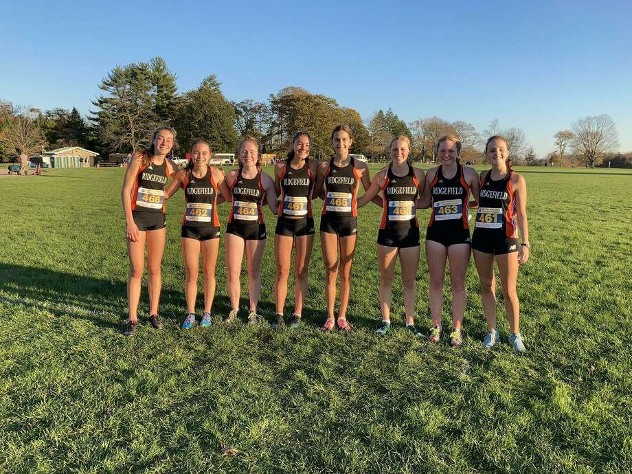 The Ridgefield girls cross country team won the FCIAC Central Region championship on Wednesday in New Canaan. Photo: Contributed Photo / Ridgefield Girls Cross Country