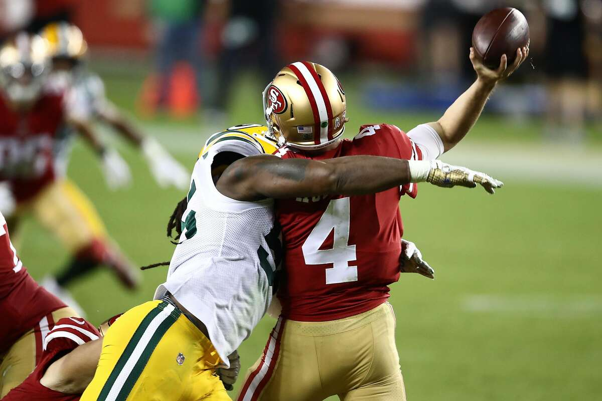 Za'Darius Smith #55 of the Green Bay Packers hits Nick Mullens #4 of the San Francisco 49ers during the second quarter at Levi's Stadium on November 05, 2020 in Santa Clara, California.