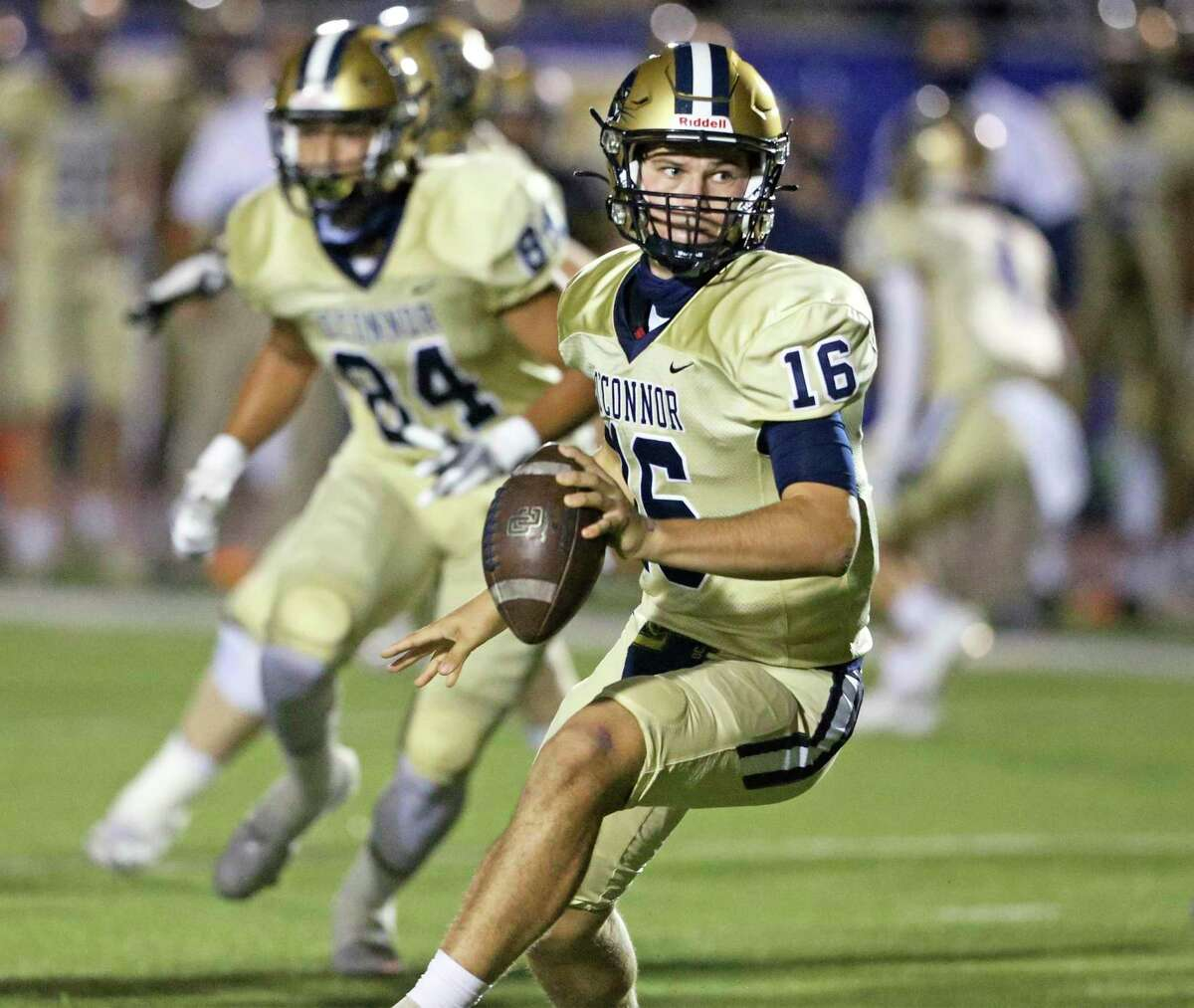 Panther quarterback Caleb Smith looks to pitch the ball back on an option to his running back as Brennan plays O'Connor in high school football at Gustafson Stadiumon Nov. 6, 2020.