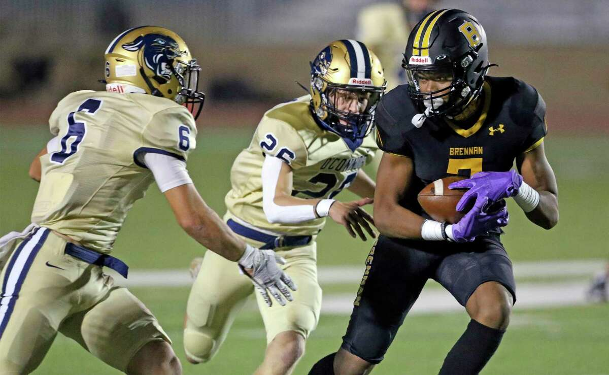 Bear receiver Jalin Spells turns downfield with a long pass reception on his team's first possession as Brennan plays O'Connor in high school football at Gustafson Stadiumon Nov. 6, 2020. Defending are Panthers Kyler Goodman (6) and Ethan Hanson (26).