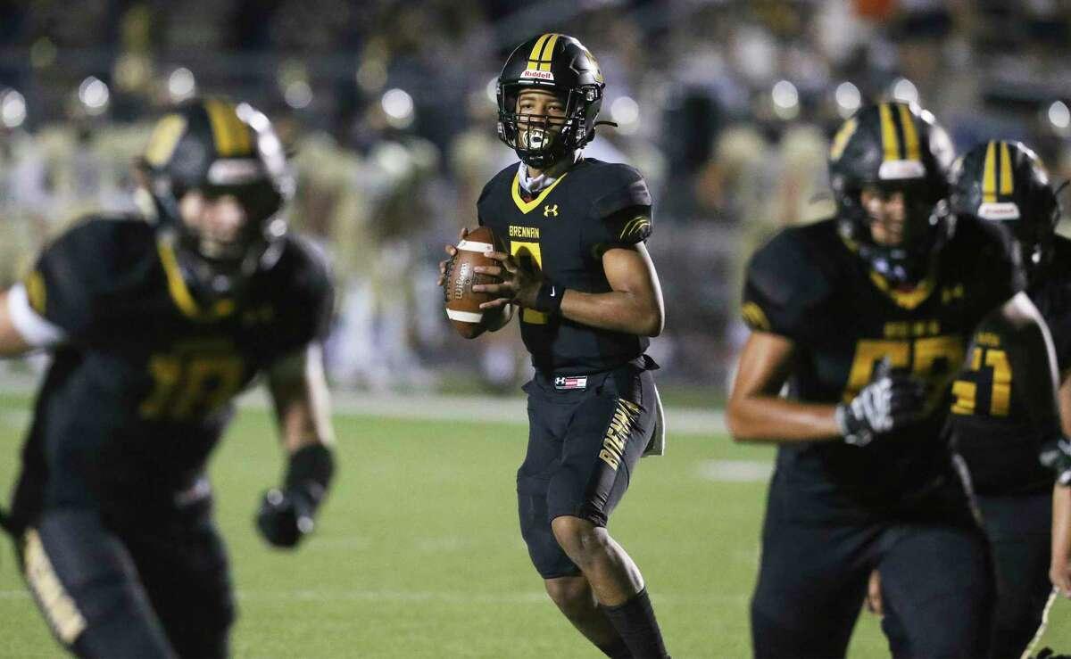 Bear quarterback Ashton Dubose looks for a receiver behind good protection as Brennan plays O'Connor in high school football at Gustafson Stadiumon Nov. 6, 2020.