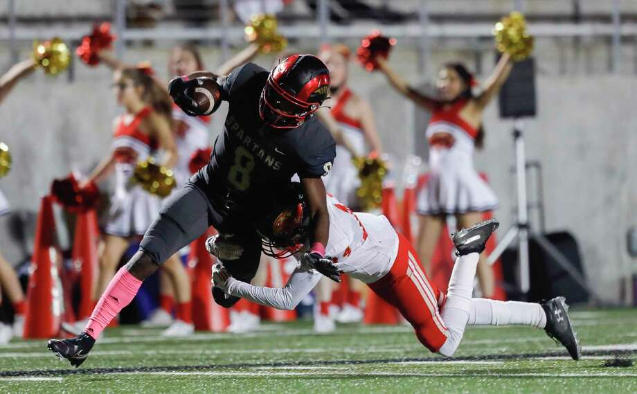 Porter wide receiver Jaylynn Briley (8) is tackled by Caney Creek defensive back Andis Lazo (24) after picking up a 58-yard gain during the first quarter of a District 8-5A high school football game at Randall Reed Stadium, Thursday, Nov. 5, 2020, in New Caney. Photo: Jason Fochtman, Houston Chronicle / Staff Photographer / 2020 © Houston Chronicle