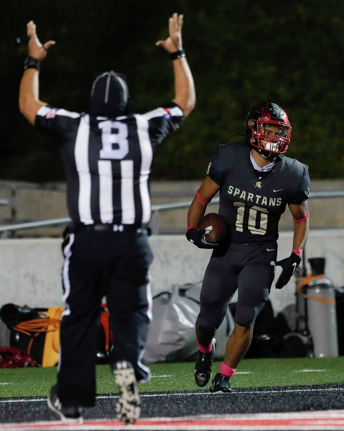 Porter running back Joshua Evans-Pickens (10) reacts after running for a 91-yard touchdown during the third quarter of a District 8-5A high school football game at Randall Reed Stadium, Thursday, Nov. 5, 2020, in New Caney.