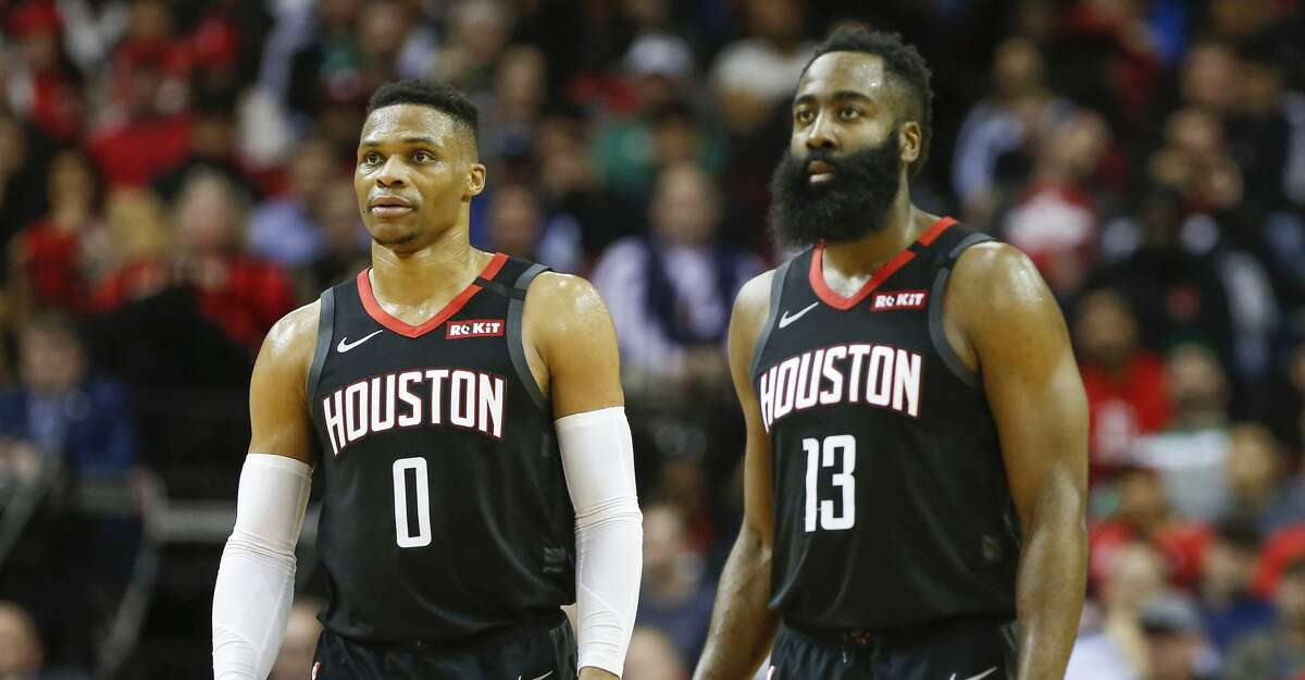 Houston Rockets guard Russell Westbrook (0) and guard James Harden (13) during the second half of an NBA basketball game at Toyota Center on Tuesday, Feb. 11, 2020, in Houston.