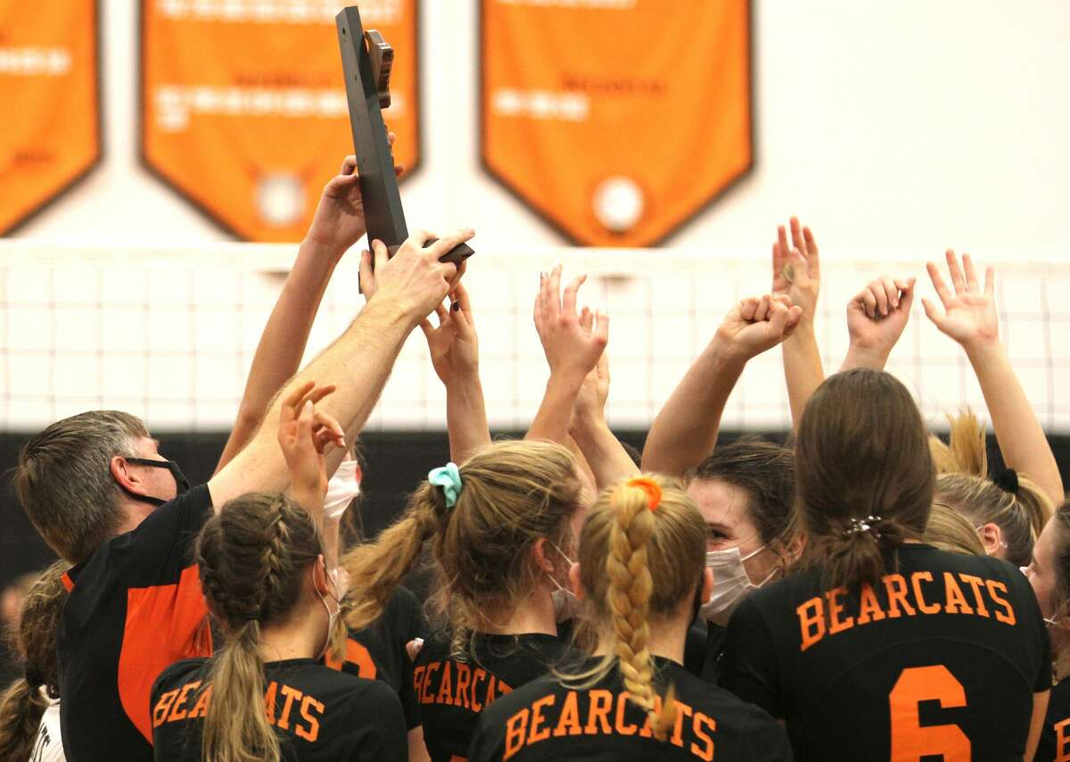 The Ubly varsity volleyball team pushed past North Huron in four sets on Thursday night to win a second-straight district championship. The Bearcats won, 25-10, 25-11, 23-25, 25-18.