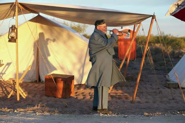 """Re-enactor Timothy Phillips practices before the raising of the """"Stars and Bars"""" flag during a morning ceremony at Horse Head Crossing in Pecos County on Oct. 31, 2020. The flag was the first used by the Confederate States of America."""
