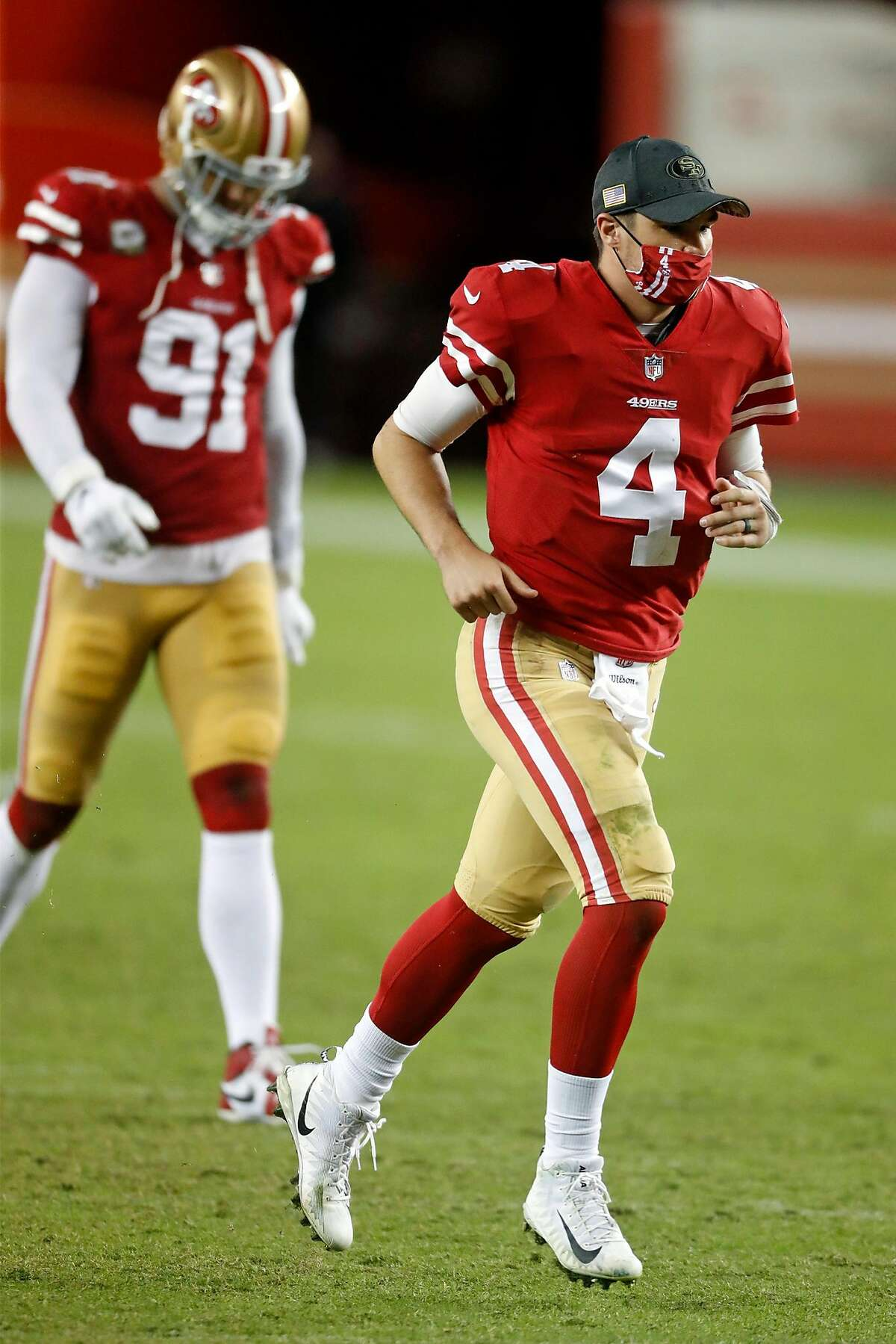 San Francisco 49ers' Nick Mullens and Arik Armstead leave the field after Niners' 34-17 loss to Green Bay Packers in NFL game at Levi's Stadium in Santa Clara, Calif., on Thursday, November 5, 2020.