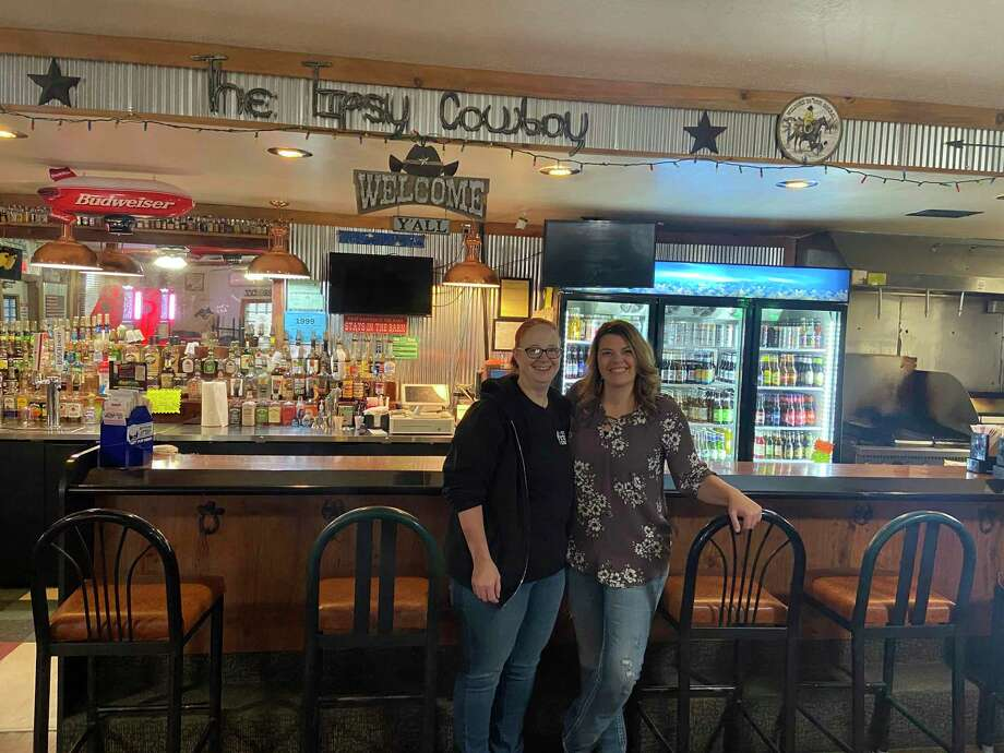 Sisters Janice Hebert (left) and Tina Goodman are shown in their Pinconning restaurant, Tipsy Cowboy, an establishment that reaped financial and marketing benefits of a successful Buy Bay County Gift Card Stimulus Program. Like many small businesses, the Tipsy Cowboy was struggling to remain on solid financial ground in the throes of the COVID-19 pandemic. Goodman credited the program for giving their business a much-needed boost. (Photo Provided)