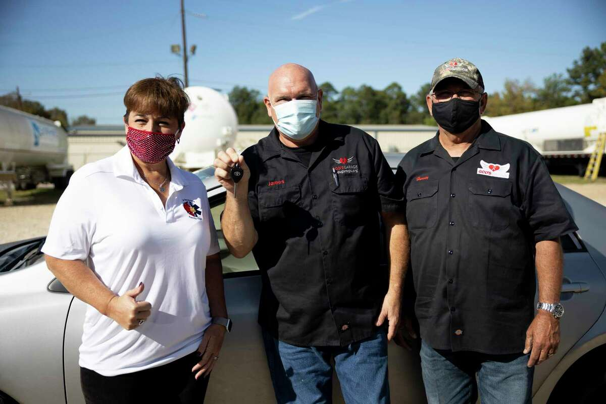 From left to right, Desi Bittner, James Winteer and Harvey Yaw pose for a portrait at God's Garage in Conroe, Thursday, Nov. 5, 2020. The mission of the organization is to help single mothers, widows and wives of deployed military with a new vehicle they've fixed.