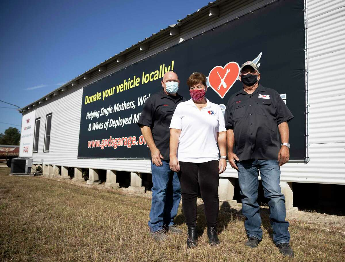 From left to right, James Minteer, Desi Bittner and Harvey Yaw pose for a portrait at God's Garage in Conroe, Thursday, Nov. 5, 2020. The mission of the organization is to help single mothers, widows and wives of deployed military with a new vehicle they've fixed.
