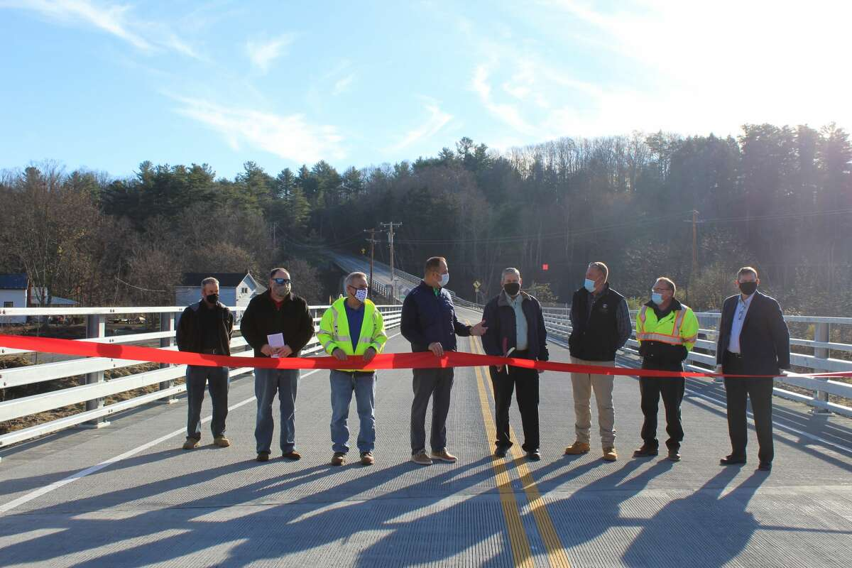 Former Montgomery County Department of Public Works Commissioner Paul Clayburn cuts the ribbon for the new Burtonsville Road Spur Bridge during a ceremony Thursday, Nov. 5, 2020.