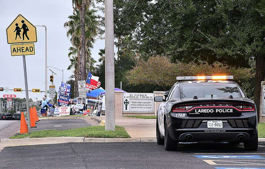 Following confrontations between the different political factions for the presidential race outside the Central Fire Station where early voting was taking place, the Laredo Police Department assigned police units to keep order. LPD does not expect any protests or violence locally due to election results. Photo: Cuate Santos / Laredo Morning Times / Laredo Morning Times