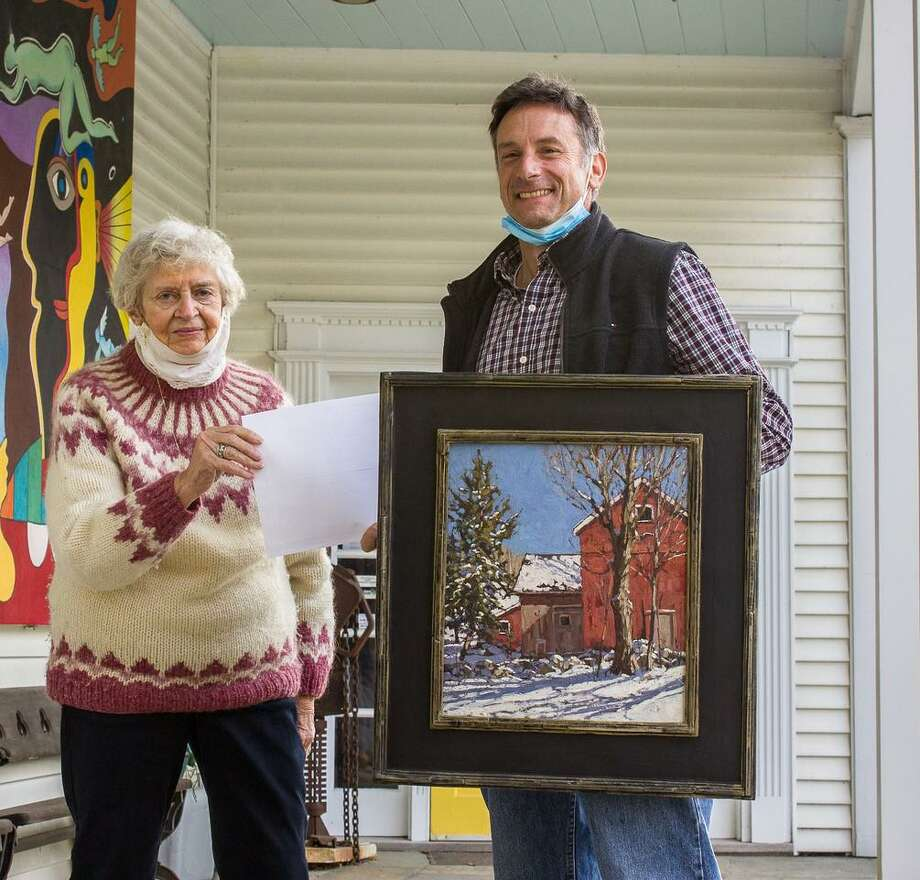 """Jim Laurino of Litchfield was one of three artists to earn an Award of Excellence for his """"Nonnewaug Barns"""" at the Kent Art Association's fall juried show. He is shown above with KAA President Connie Horton. Photo: Courtesy Of Kent Art Association / Danbury News Times Contributed"""
