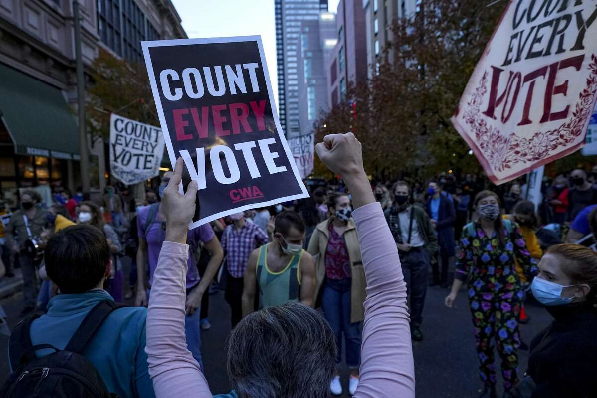 Protesters rally outside the Pennsylvania Convention Center where election votes are being counted in Philadelphia, Pennsylvania, on November 5, 2020. People from both sides were gathered. Trump supporters questioning validity of some ballots and Biden supporters pushing for the count to continue. (Photo by Bonnie Jo Mount/The Washington Post via Getty Images)