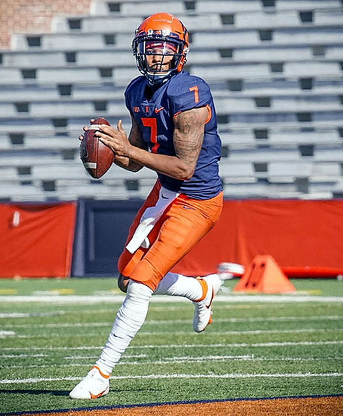 Quarterback Coran Taylor looks for a target during last Saturday's loss to Purdue at Memorial Stadium. Taylor, a sophomore from Peoria, is the fourth-string quarterback for Illinois, but was forced into action because of coronavirus and injuries to other QBs.