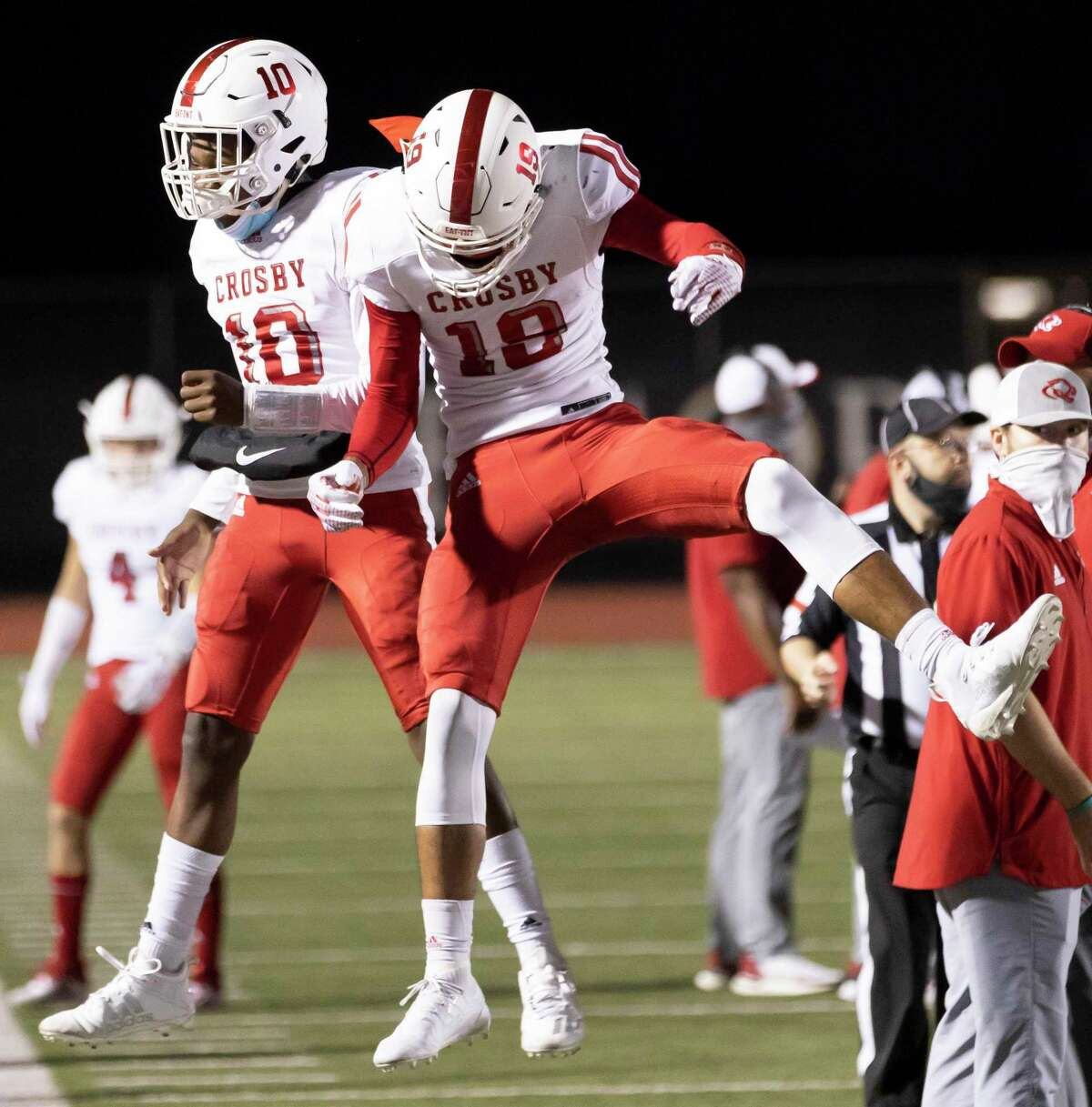 Crosby quarterback Cyrin Myles (10) and cornerback Jonathan Fuselier (19) react after they score a touchdown during the first quarter of a district 5A Division II football game against Kingwood Park at Turner Stadium, Thursday, Nov. 5, 2020, in Humble.
