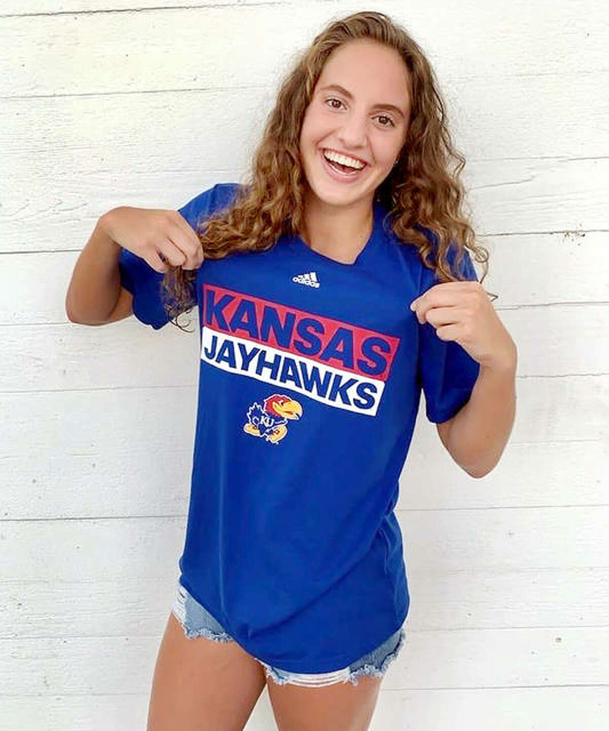 Eleni Kotzamanis, a senior at Alton High,has been named a Scholastic All-American by USA Swimming. The Alton High senior displays her college colors after making a verbal commitment to swim at the University of Kansas next year. Kotzamanis swims for the Flyers Aquatic Swim Team of St. Louis.