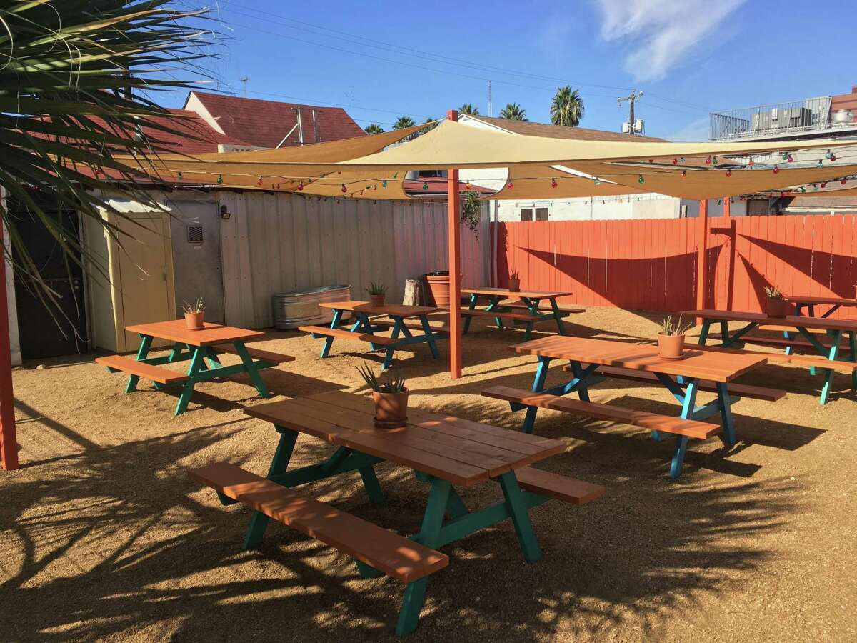 The outdoor seating space at Tony's Siesta has shade and picnic table seating.