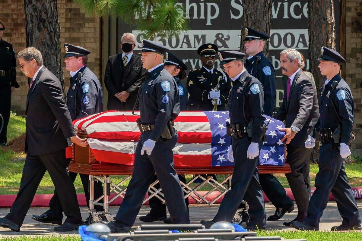 Beaumont Police officers escort the body of the slain officer from the church to the lawn where traditional police honors were carried out. On Saturday morning, the life of Officer Sheena Yarbrough-Powell was honored as she was laid to rest with a police escort from Broussard??s Mortuary to Calvary Baptist Church on Dowlen Road. Photo made on August 15, 2020. Fran Ruchalski/The Enterprise