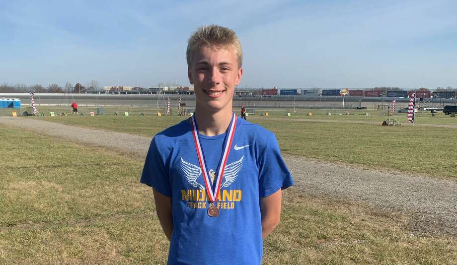 Midland High's Matthew Crowley displays his medal after finishing 17th in the Division 1 cross country state final Friday, Nov. 6, 2020, at Michigan International Speedway in Brooklyn. Photo: Photo Provided