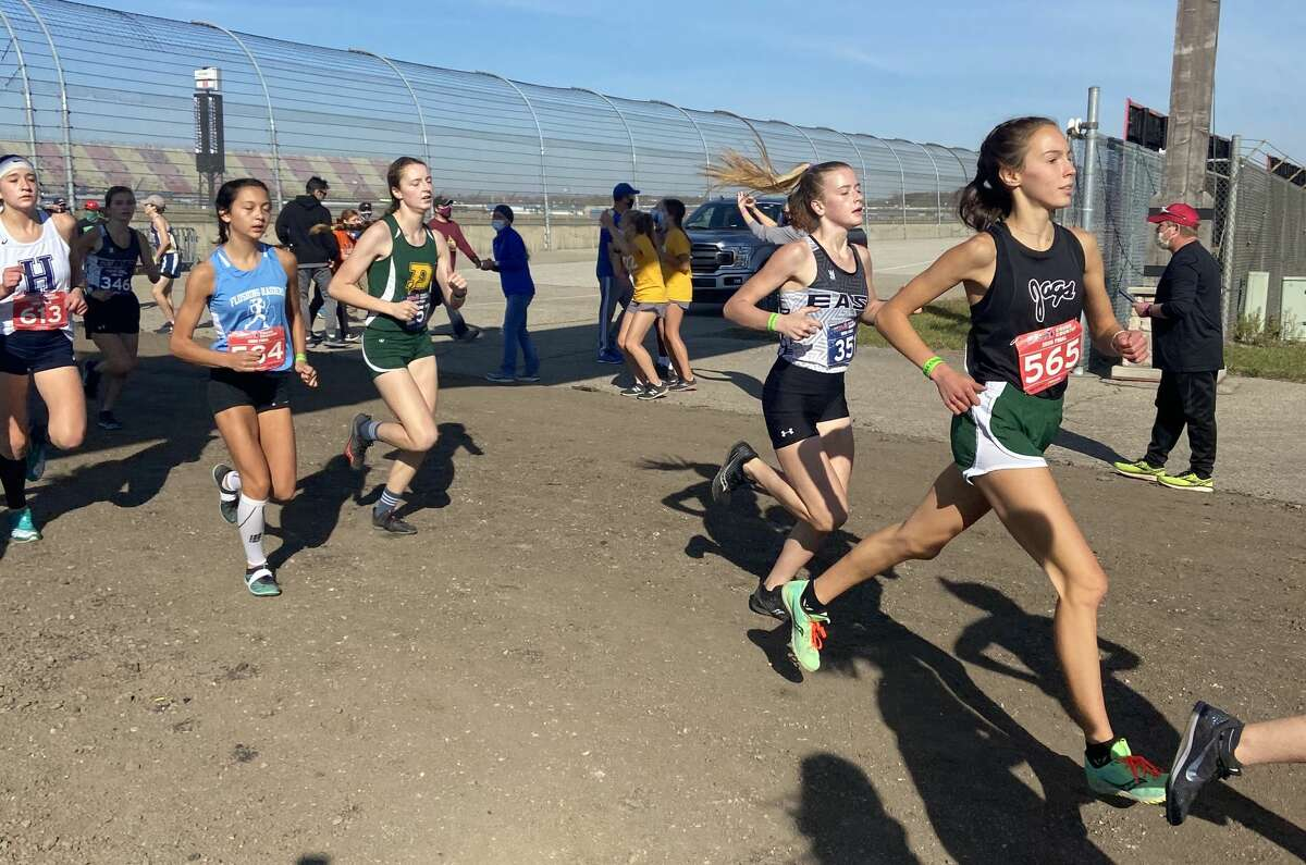 Dow High's Tristan Luick (third from left) competes in the Division 1 cross country state final Friday, Nov. 6, 2020, at Michigan International Speedway in Brooklyn.