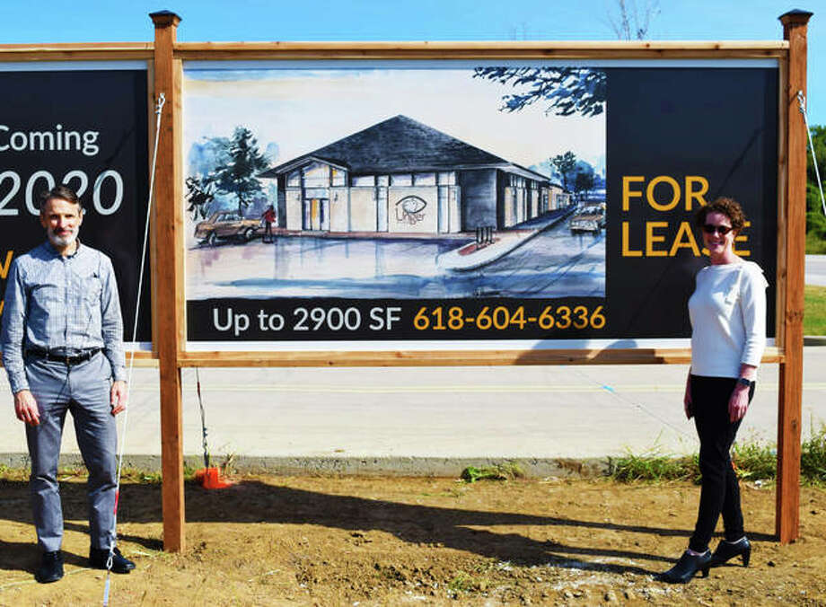 In this September file photo: Dr. Tom and Dr. Alice Unger stand next to their development sign where their new location is being built for Unger Eye Care, in Edwardsville. Photo: Tyler Pletsch | Intelligencer