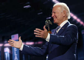 Democratic presidential nominee Joe Biden appears on stage after Democratic vice presidential nominee U.S. Sen. Kamala Harris (D-CA) spoke on the third night of the Democratic National Convention from the Chase Center August 19, 2020 in Wilmington, Delaware.