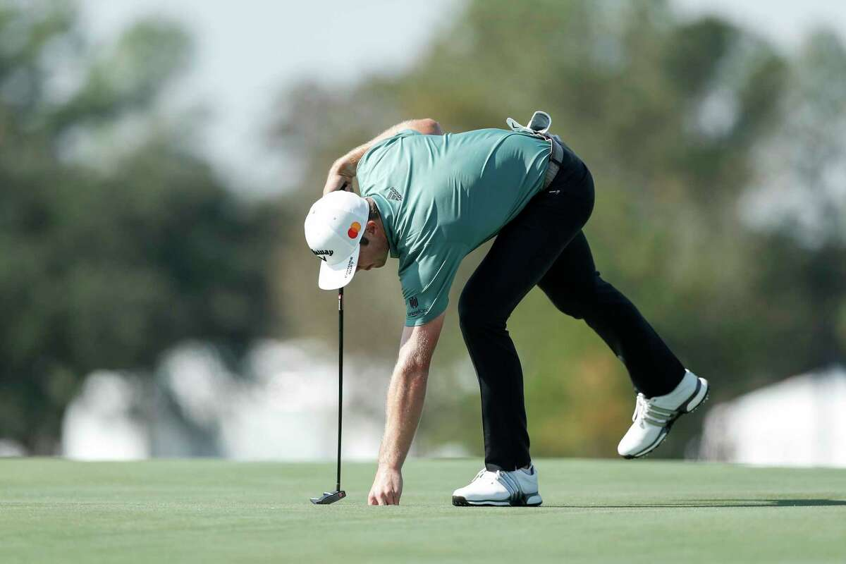 Sam Burns putts on the 18th green during the second round of the Vivint Houston Open at Memorial Park Golf Course on Friday, November 6, 2020.