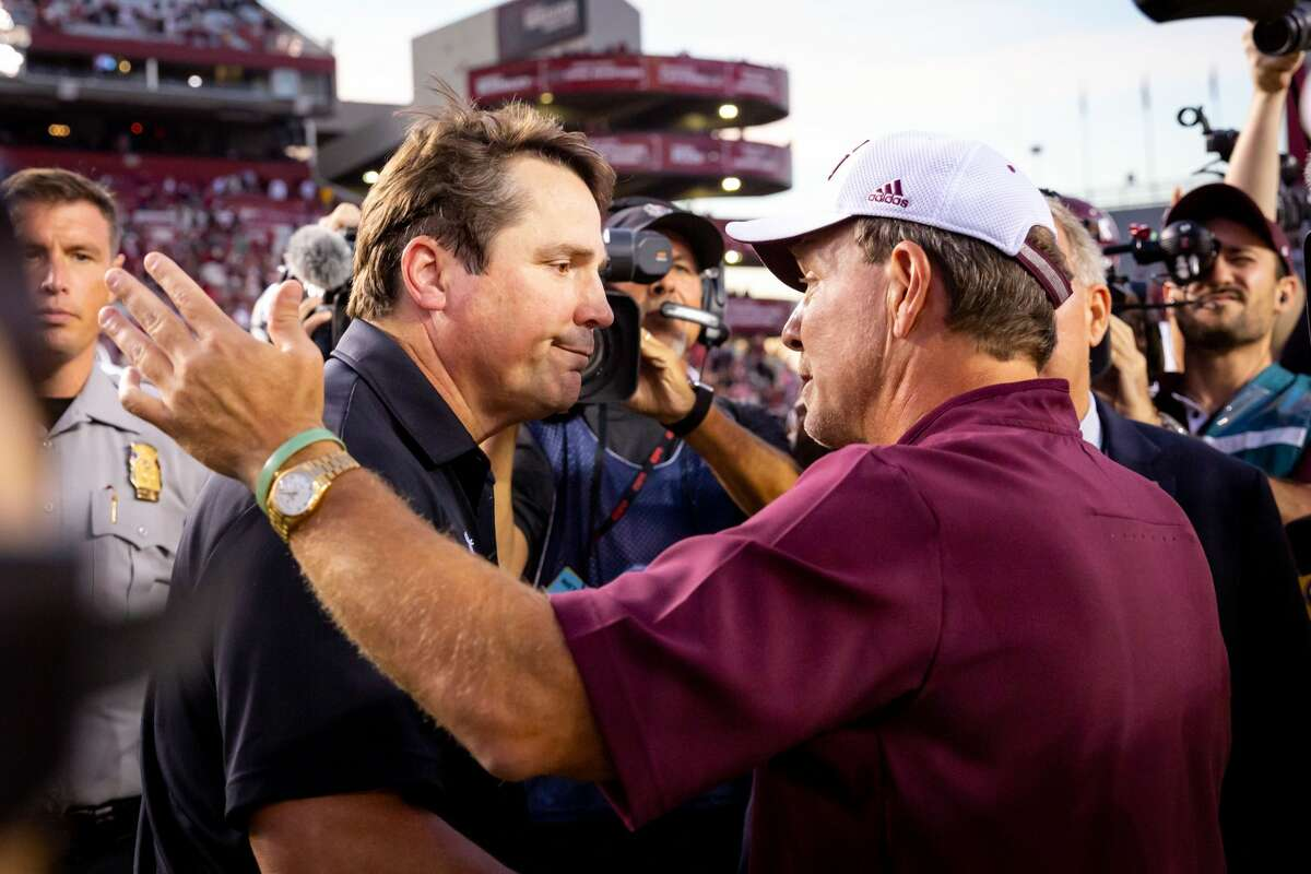 Will Muschamp (left) and Jimbo Fisher were both assistants on Nick Saban's staff at LSU.
