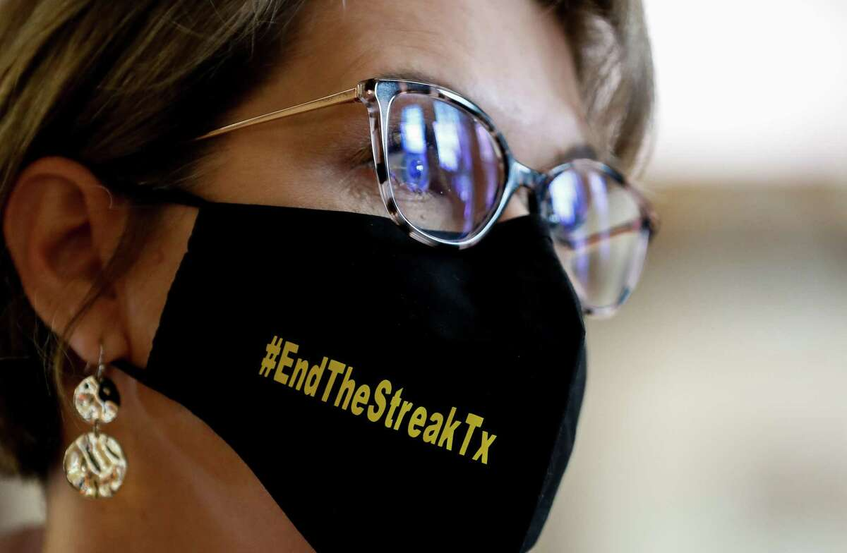 Texas Transportation Commissioner Laura Ryan wears a #EndTheStreakTx face mask inside Houston City Hall, following a press conference where officials talked to reporters about roadway fatalities in the city and the state, on Nov. 5, 2020. The last time no one died on a Texas road was Nov. 7, 2000.
