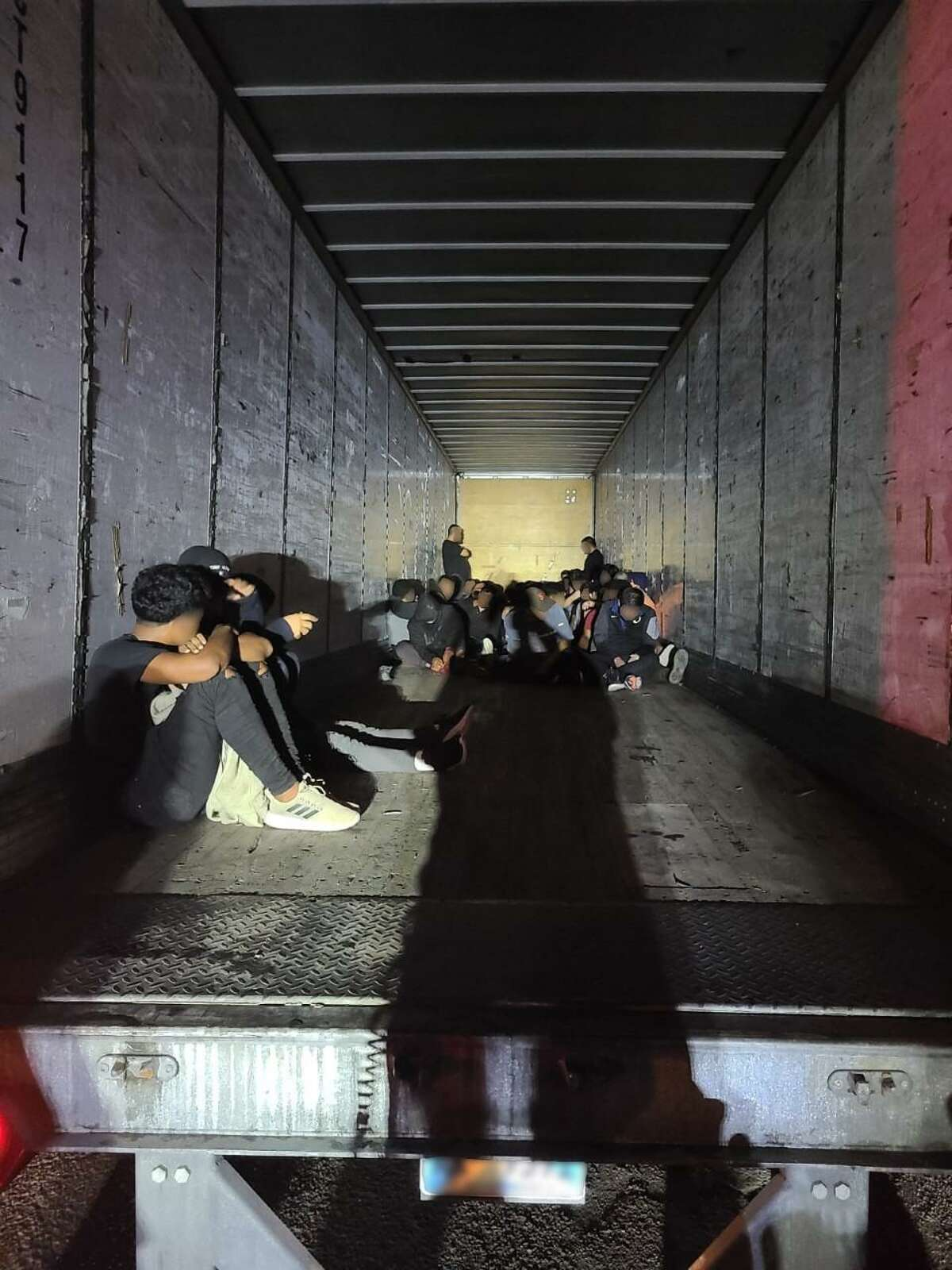 Laredo police officers discovered 67 people inside an abandoned locked trailer. U.S. Border Patrol determined that all were immigrants who were in the country illegally.