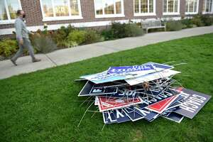 A pile of political signs outside Town Hall in Greenwich after Election Day 2020.