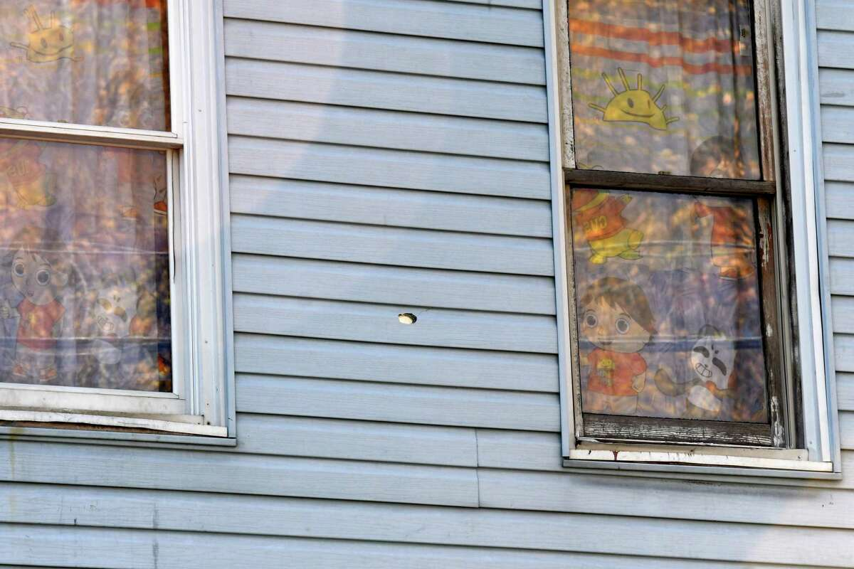 A bullet hole is visible between two bedroom windows on the former Smith family home at 114 Second Avenue on Friday, Nov. 6, 2020, in Albany, N.Y. (Will Waldron/Times Union)