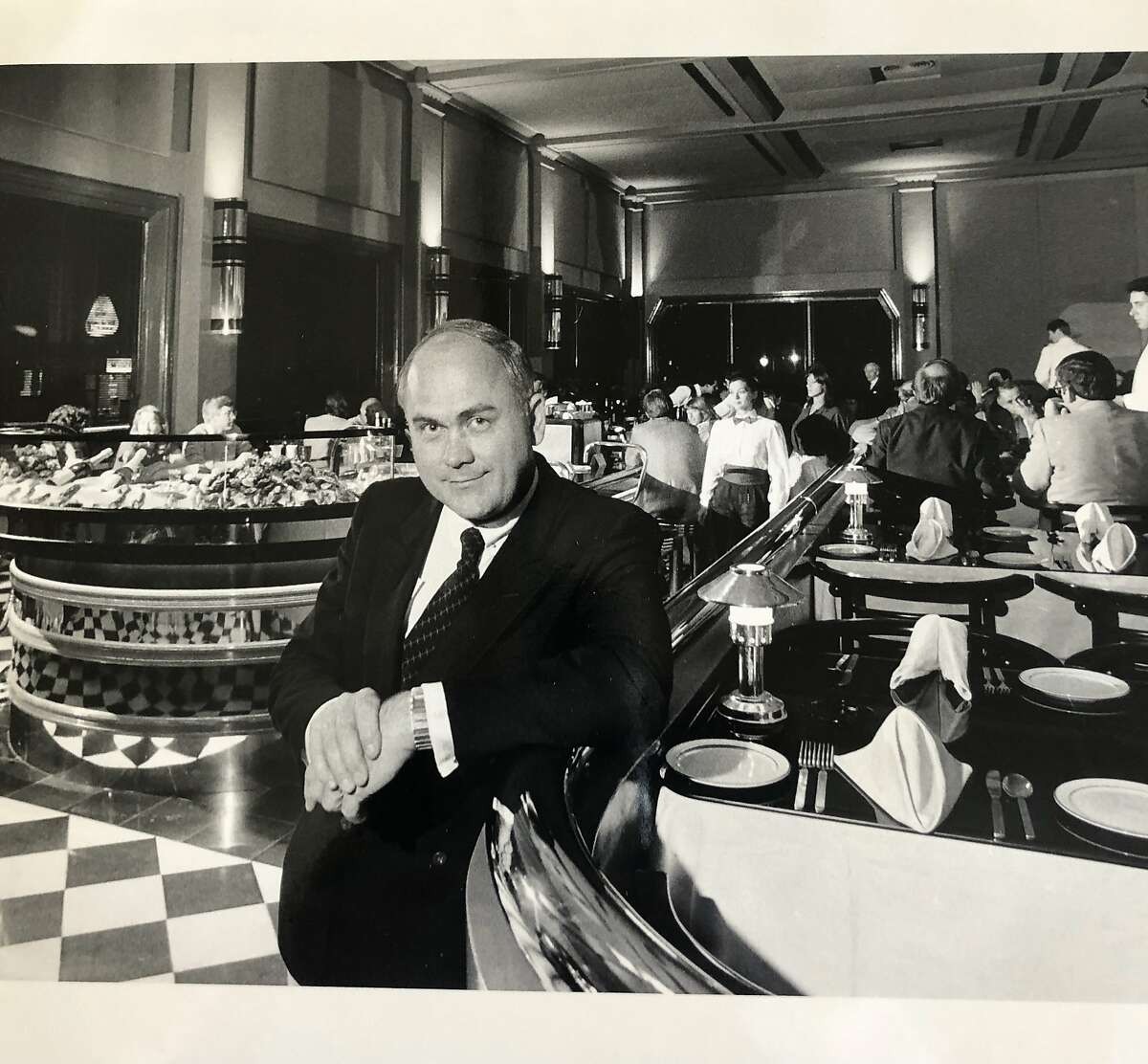 Sam DuVall poses for a portrait inside one of his swanky San Francisco restaurants, Cafe Royale, in 1983.