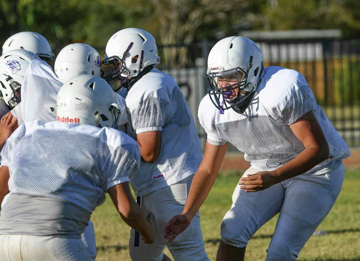 Nate Borrego, right, prepares to throw a block during Young Men's Leadership Academy football practice on Wednesday, Oct. 21, 2020.