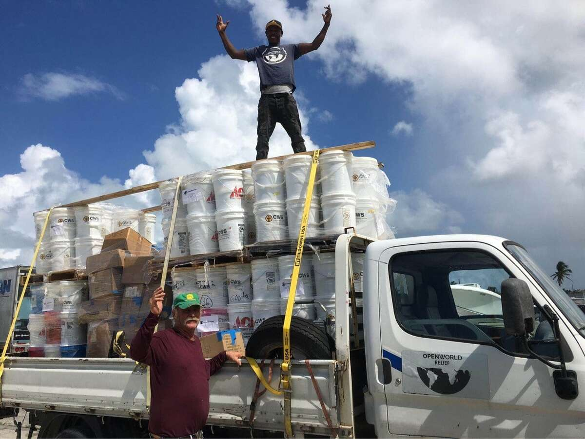 Volunteers deliver food to hurricane victims in the Bahamas.