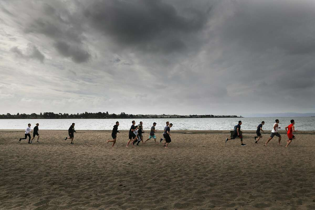 Clouds above Alameda Beach on Friday portend the cooler and wet weather expected in the Bay Area.