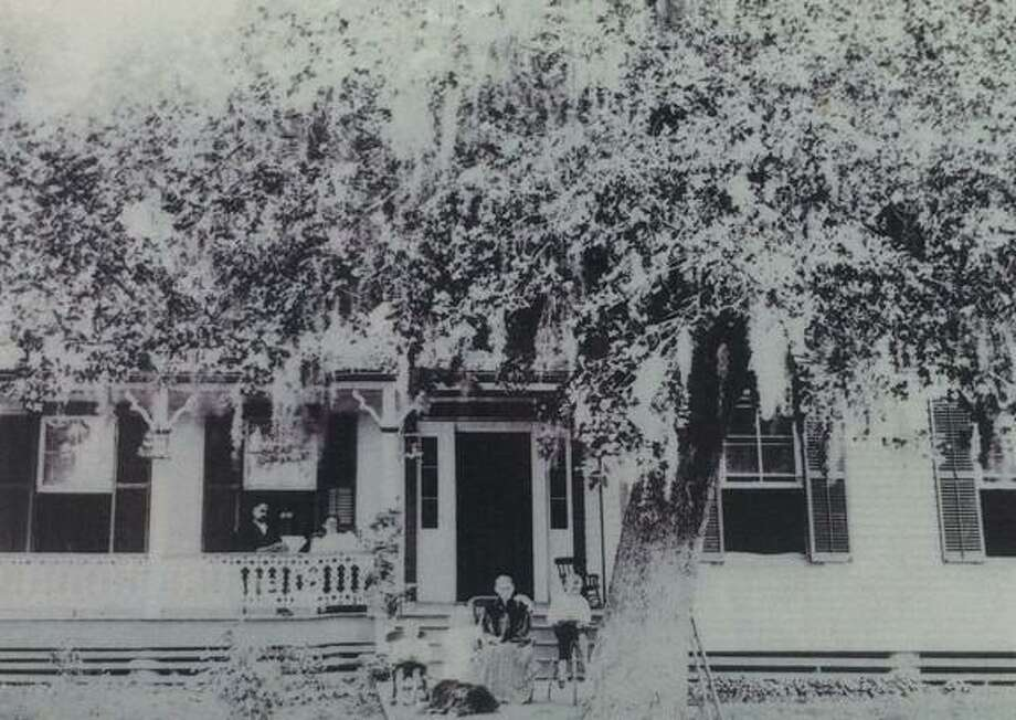The Addison-Gandy Home in Montgomery around 1899. John B. Addison and Martha Davis Addison are on the porch to the left. Her mother, Sarah Davis, is seated in front of the house with three of the Addison children. Photo: Photo Courtesy The Montgomery County Historical Commission