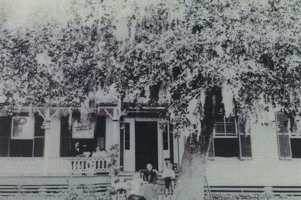 The Addison-Gandy Home in Montgomery around 1899. John B. Addison and Martha Davis Addison are on the porch to the left. Her mother, Sarah Davis, is seated in front of the house with three of the Addison children.