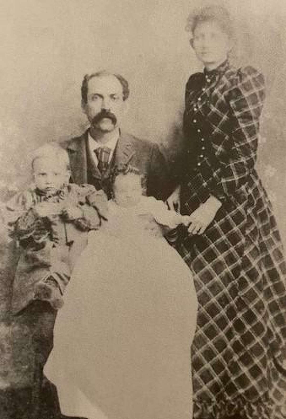 John B. Addison and wife Martha Davis Addison and their son Hart Addison and a baby who died in 1891.